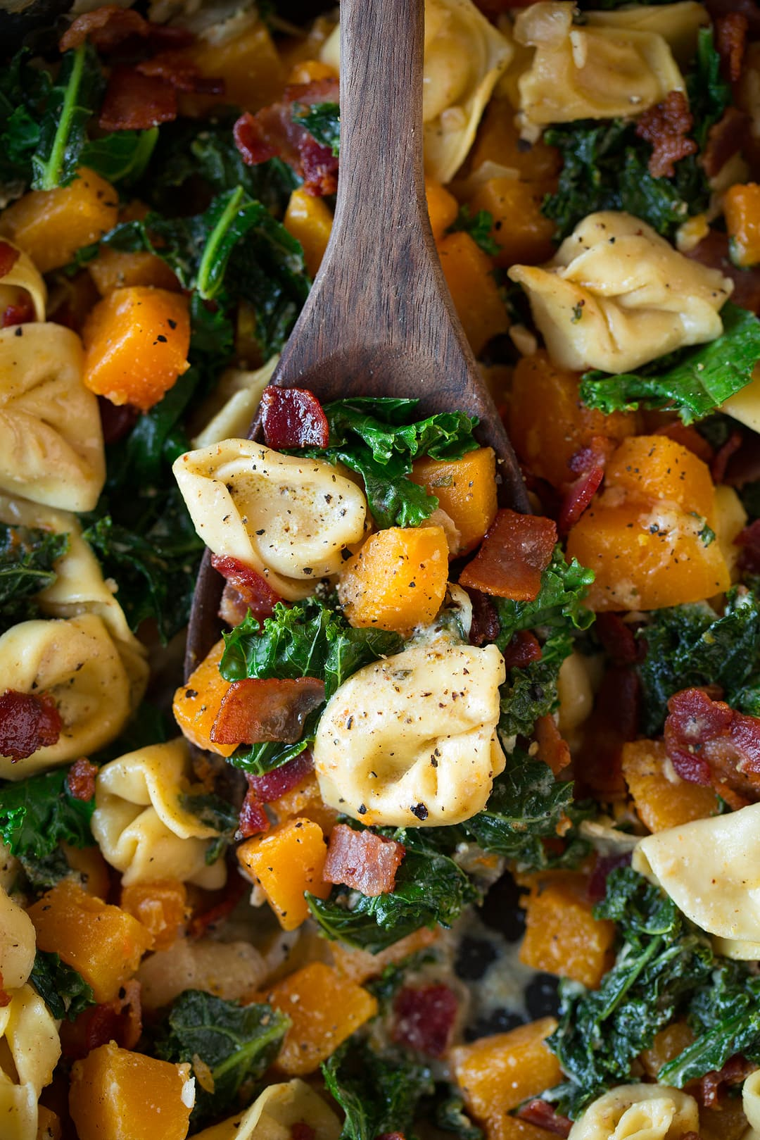 Tortellini with Butternut Squash Kale and Bacon close up image