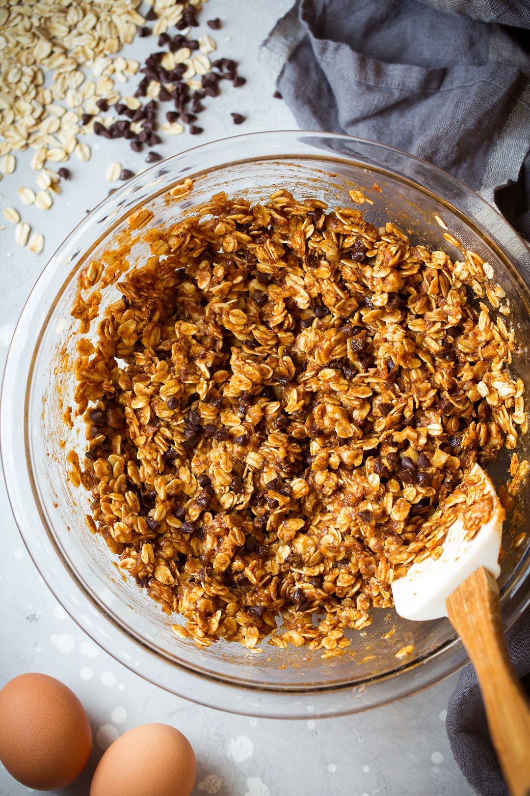 Breakfast Cookies batter in a bowl with oats, pumpkin and chocolate chips.
