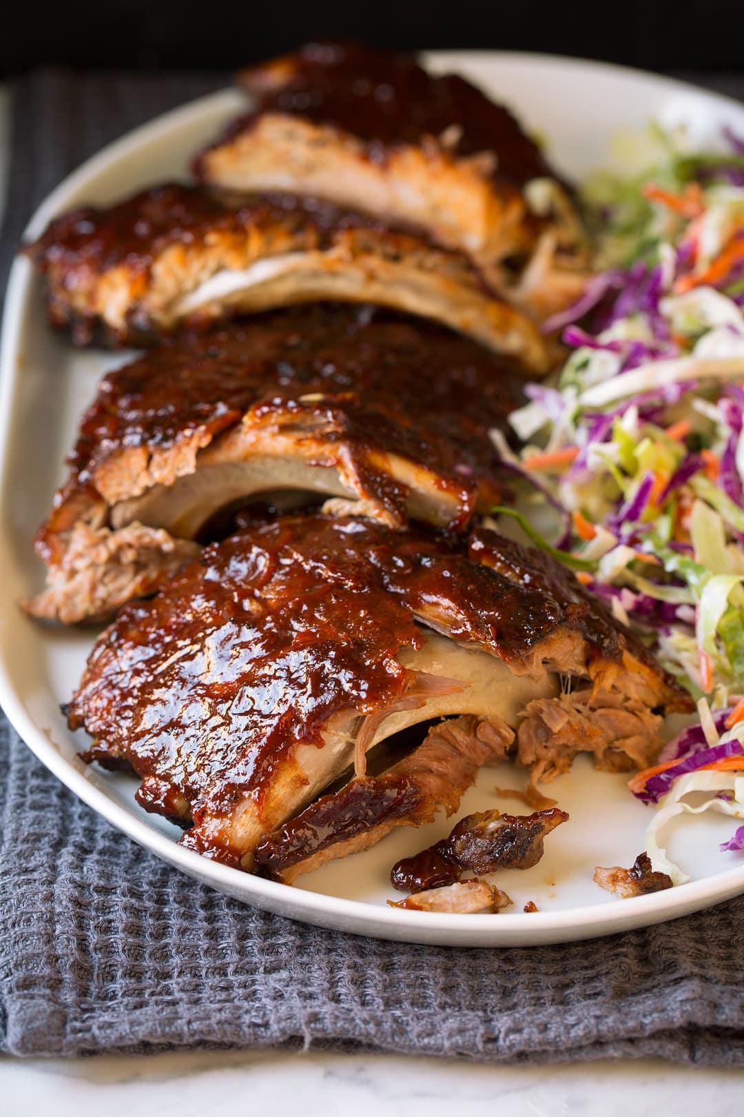 Slow Cooker Ribs with coleslaw on white plate