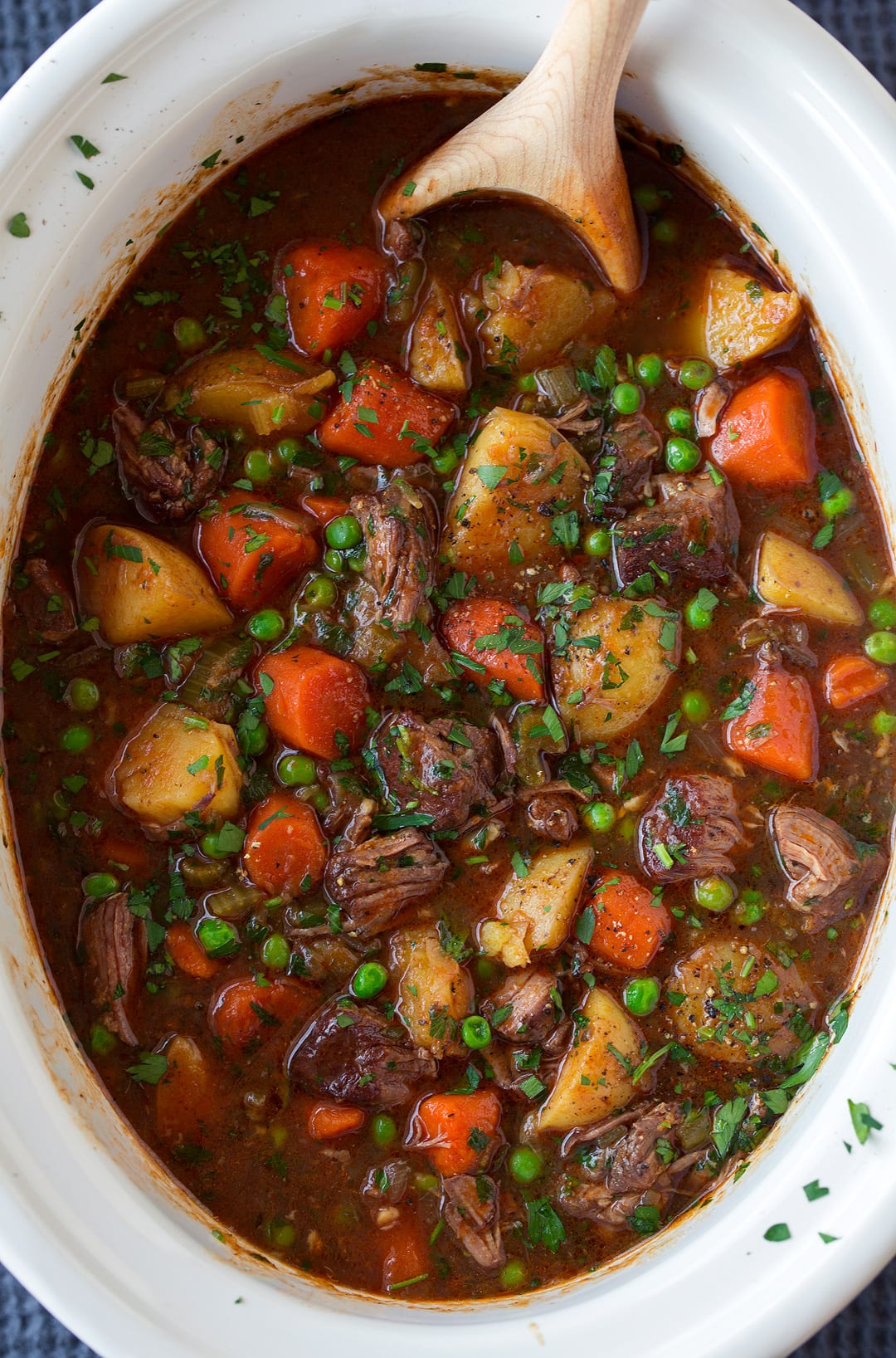 slow cooker Beef Stew with wooden spoon