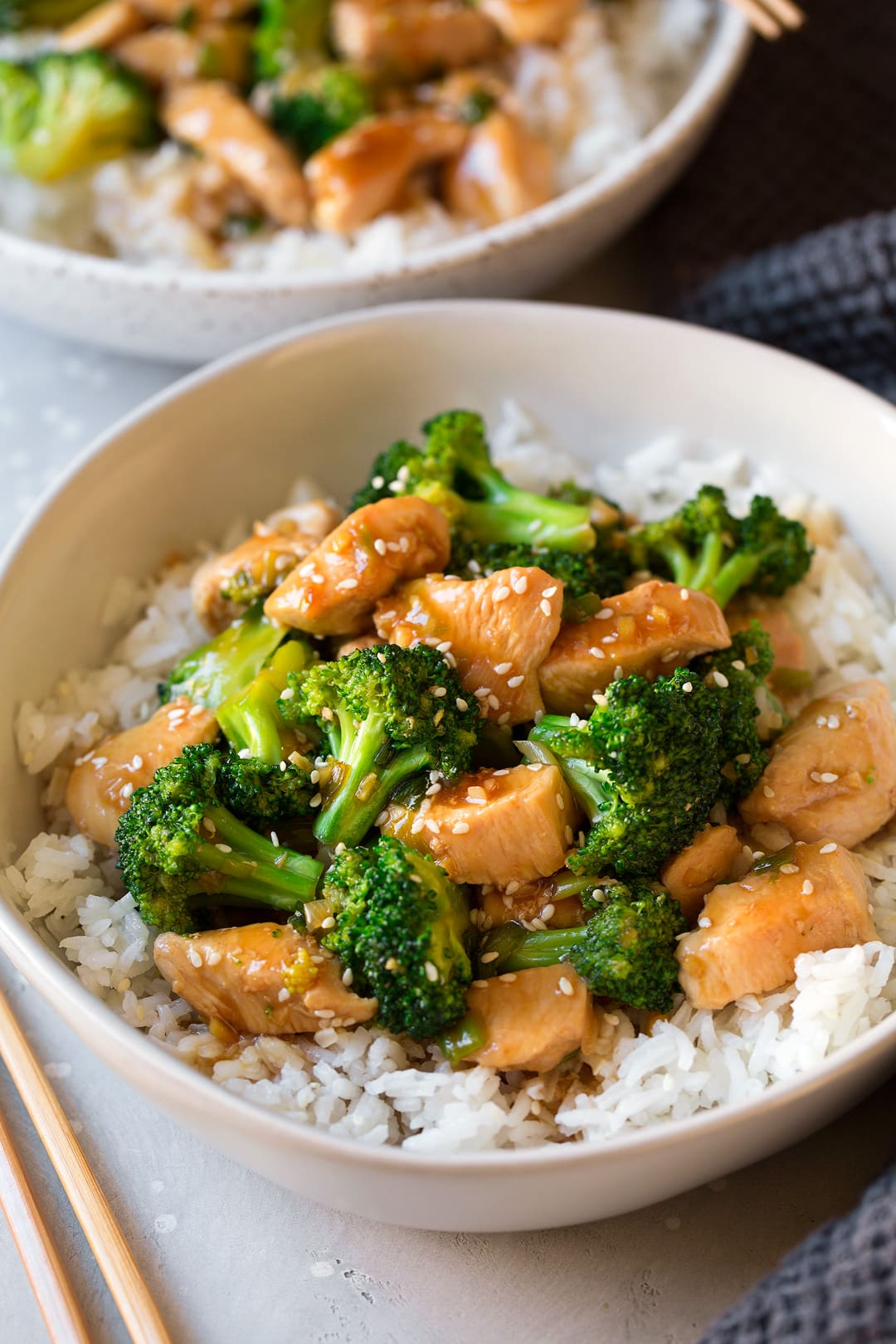 Chicken and Broccoli Stir Fry atop white rice in large bowl
