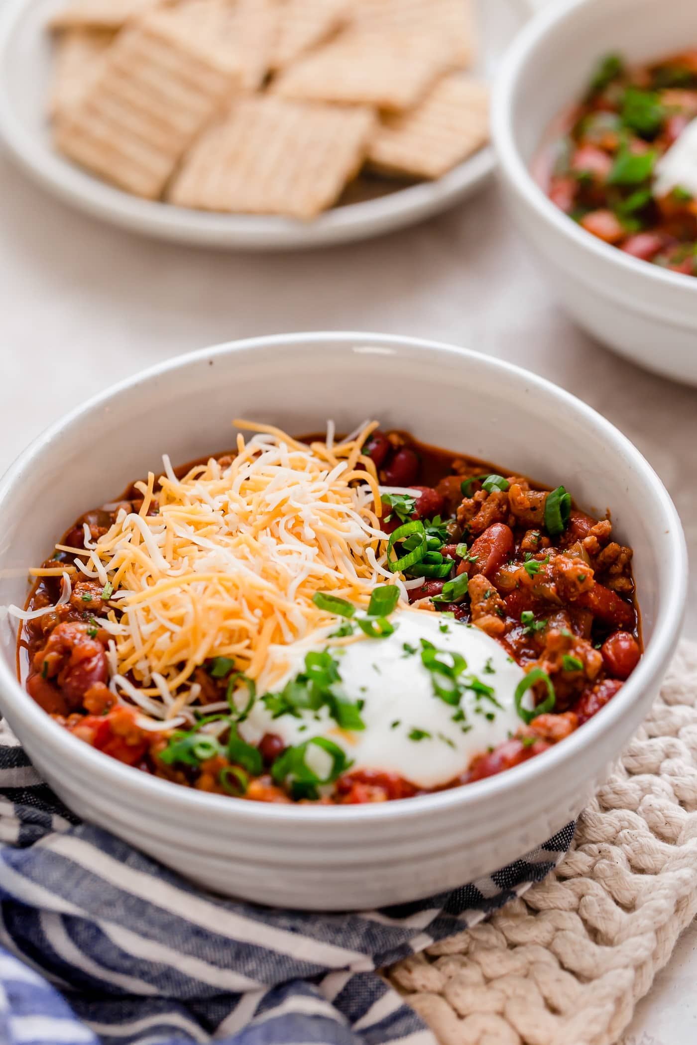 Turkey chili in a white serving bowl.