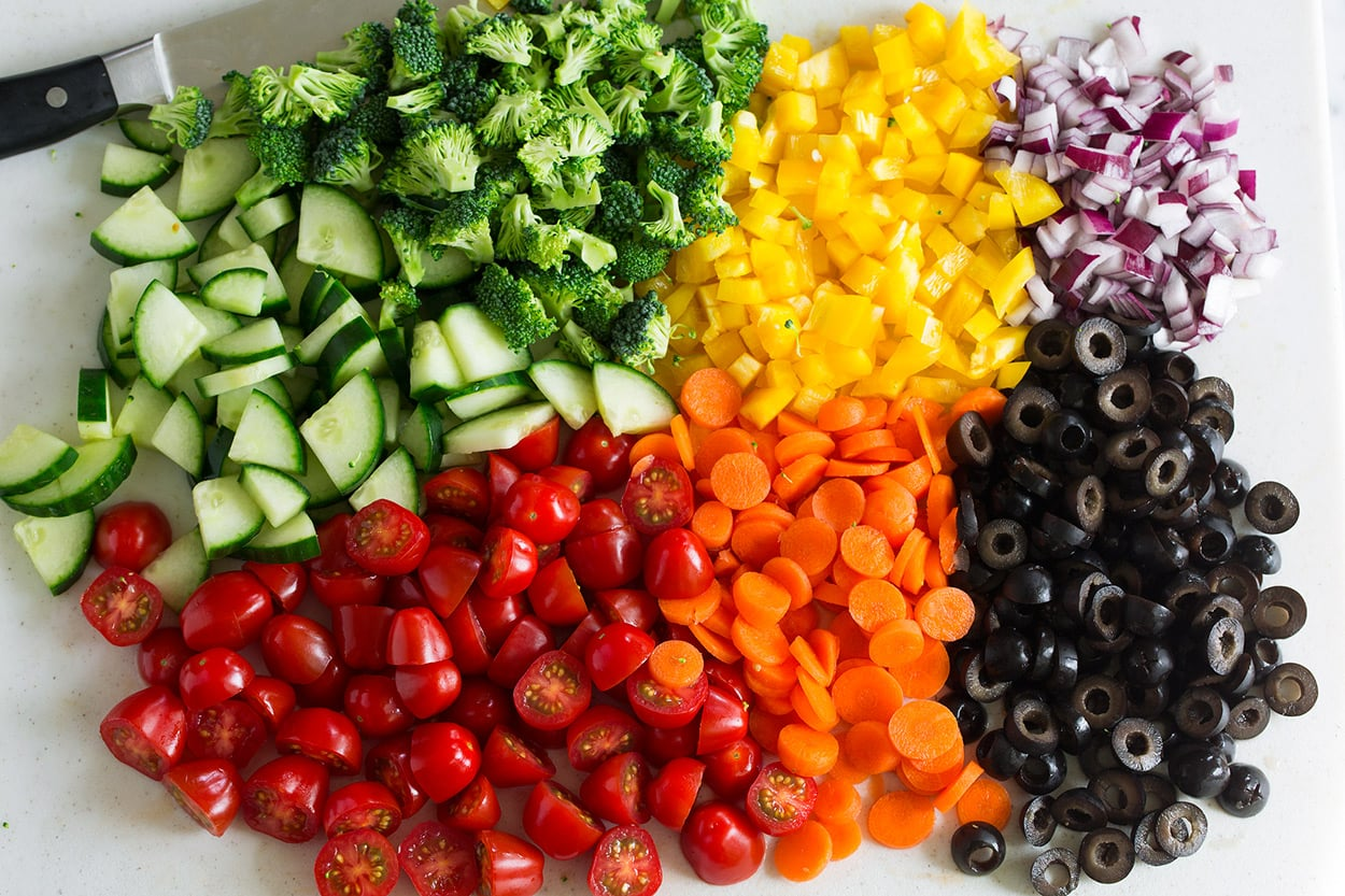 chopped vegetables for pasta salad tomatoes cucumbers carrots bell peppers olives red onion broccoli