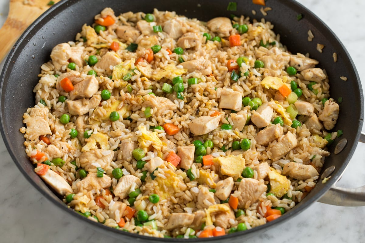 Completed chinese chicken fried rice all tossed together in a large skillet.