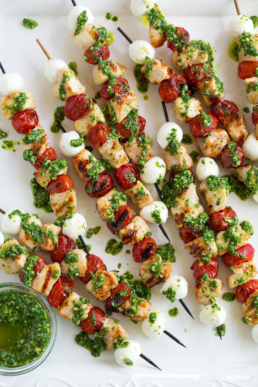 Chicken Caprese Skewers drizzled with homemade pesto