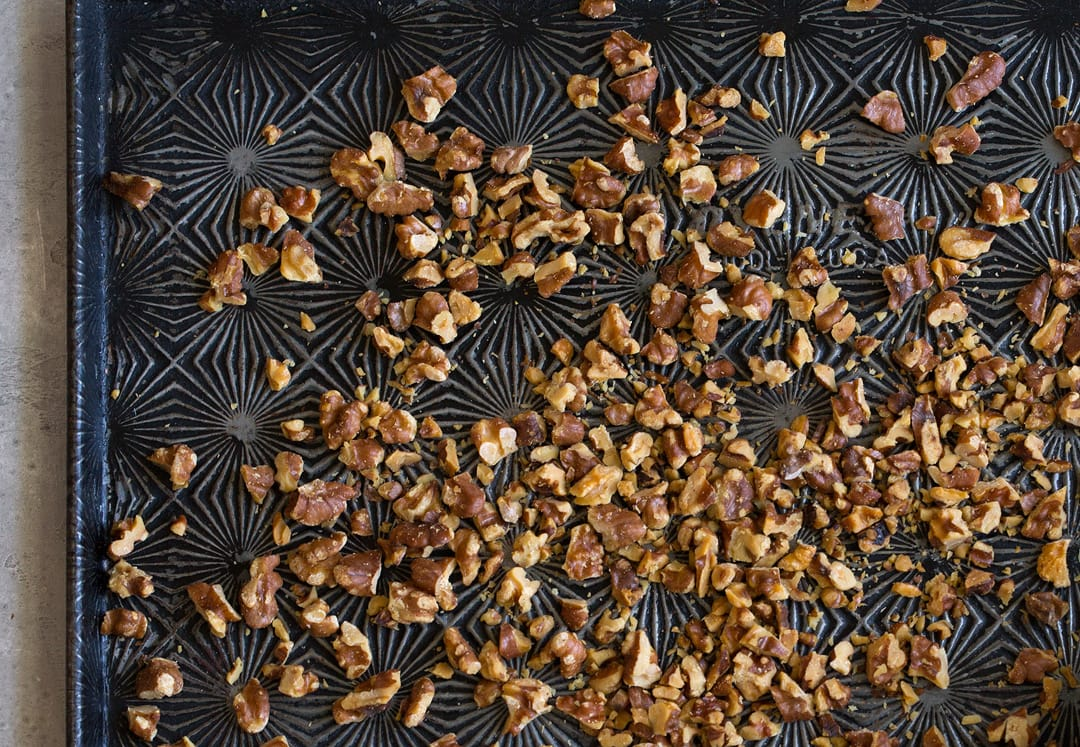 toasted walnuts on baking sheet