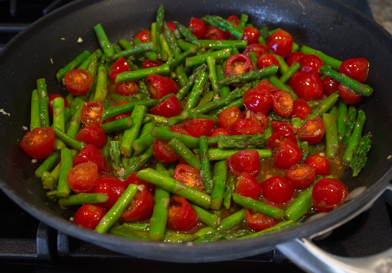 asparagus and tomatoes sauteed in butter and oil with garlic