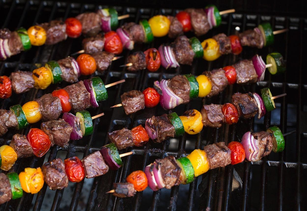 steak kebabs on grill