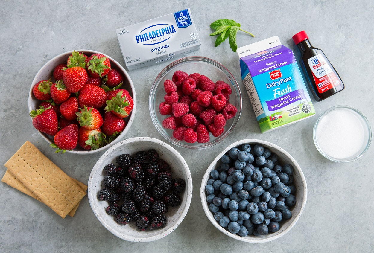 Berry Cheesecake Fruit Salad ingredients strawberries raspberries blackberries blueberries graham crackers cream cheese cream vanilla mint