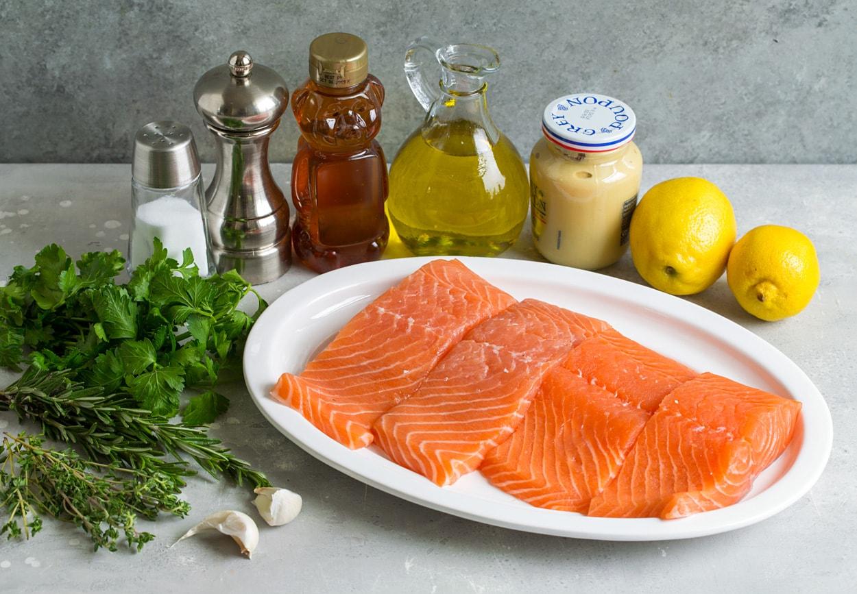 ingredients for grilled salmon lemons mustard olive oil honey salt pepper fresh herbs garlic salmon