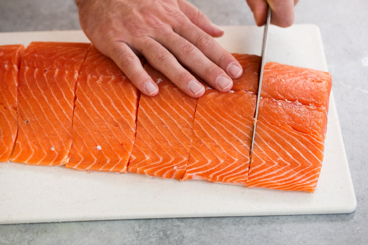 slicing salmon for grilled salmon