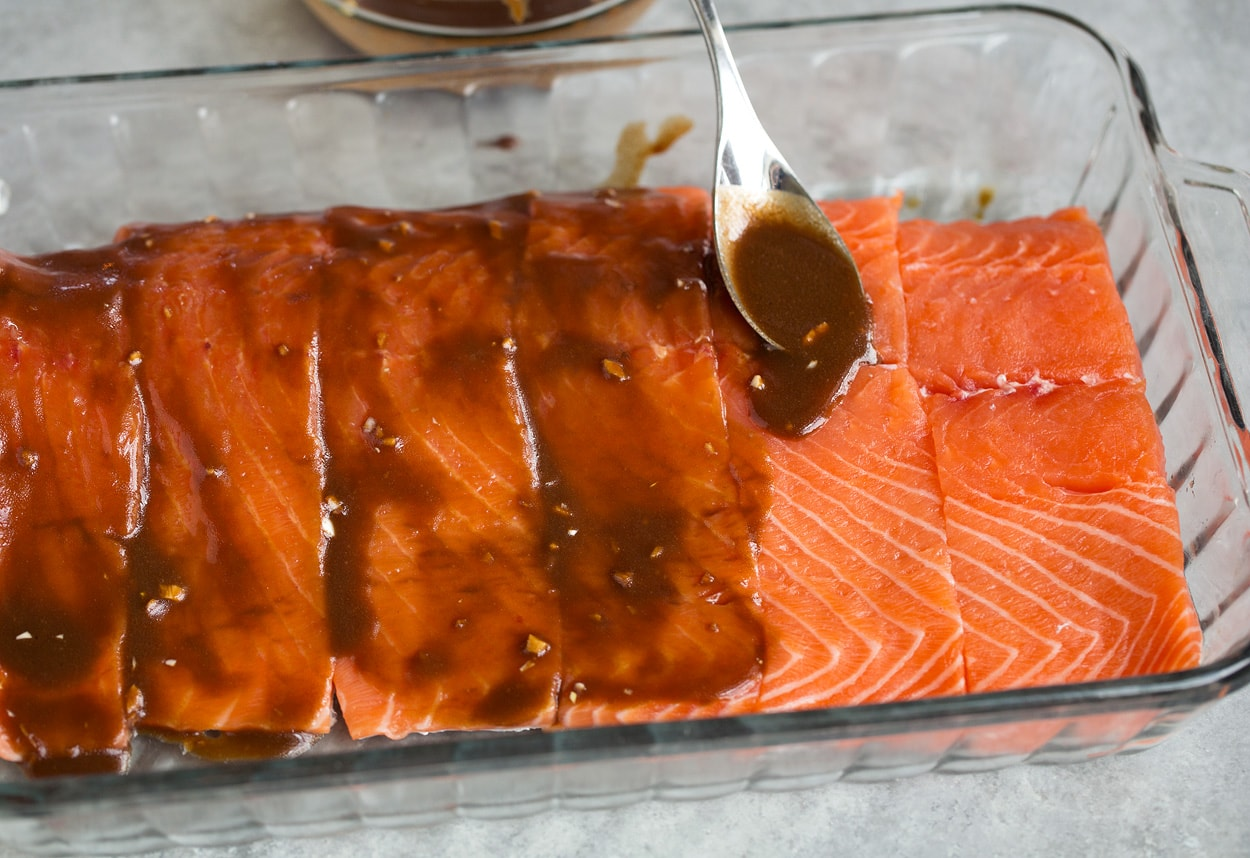 spooning marinade over salmon for grilled salmon