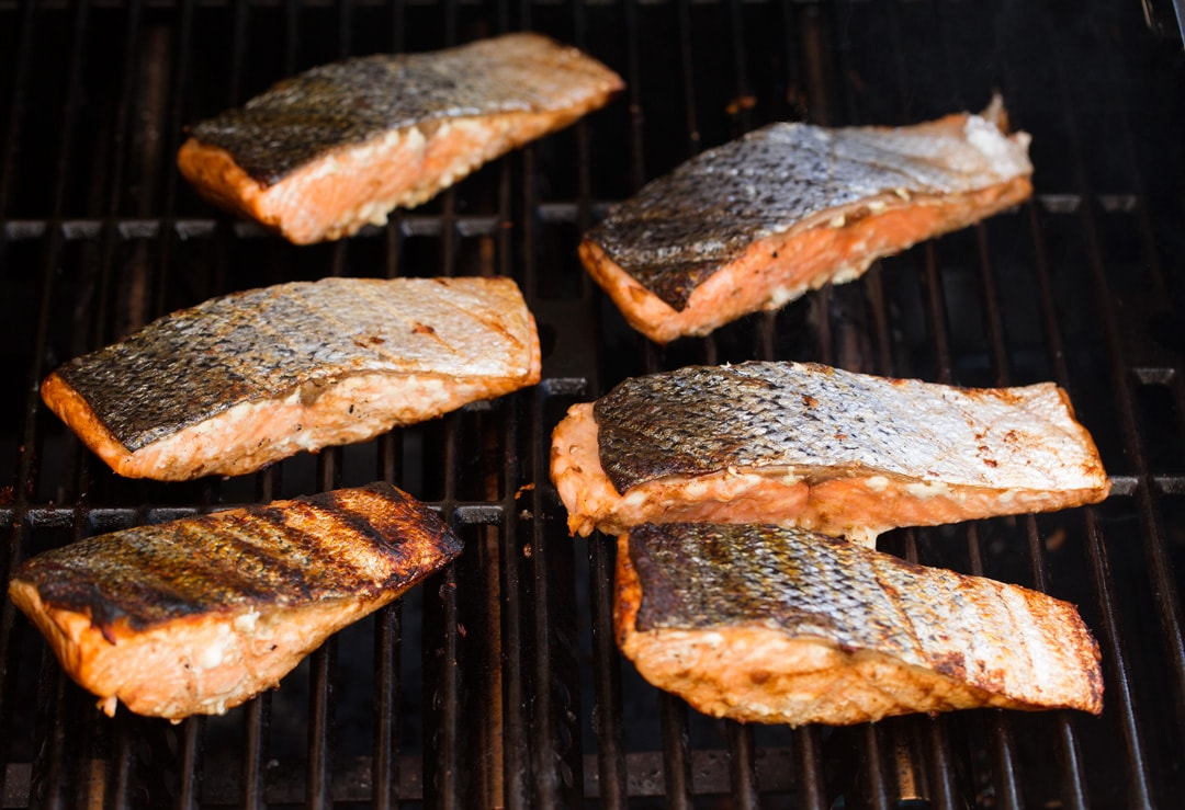 grilling 6 portions of salmon on grill