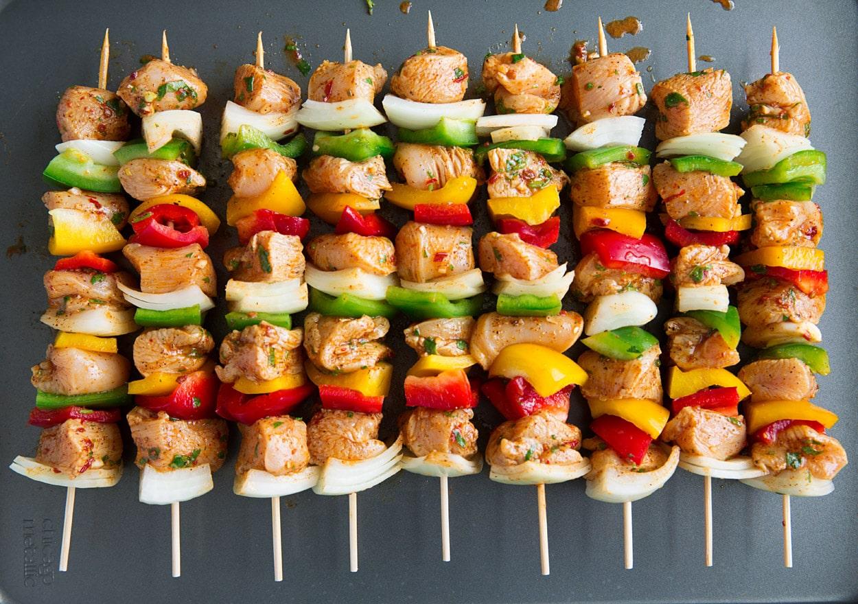 kebabs before grilling on sheet pan