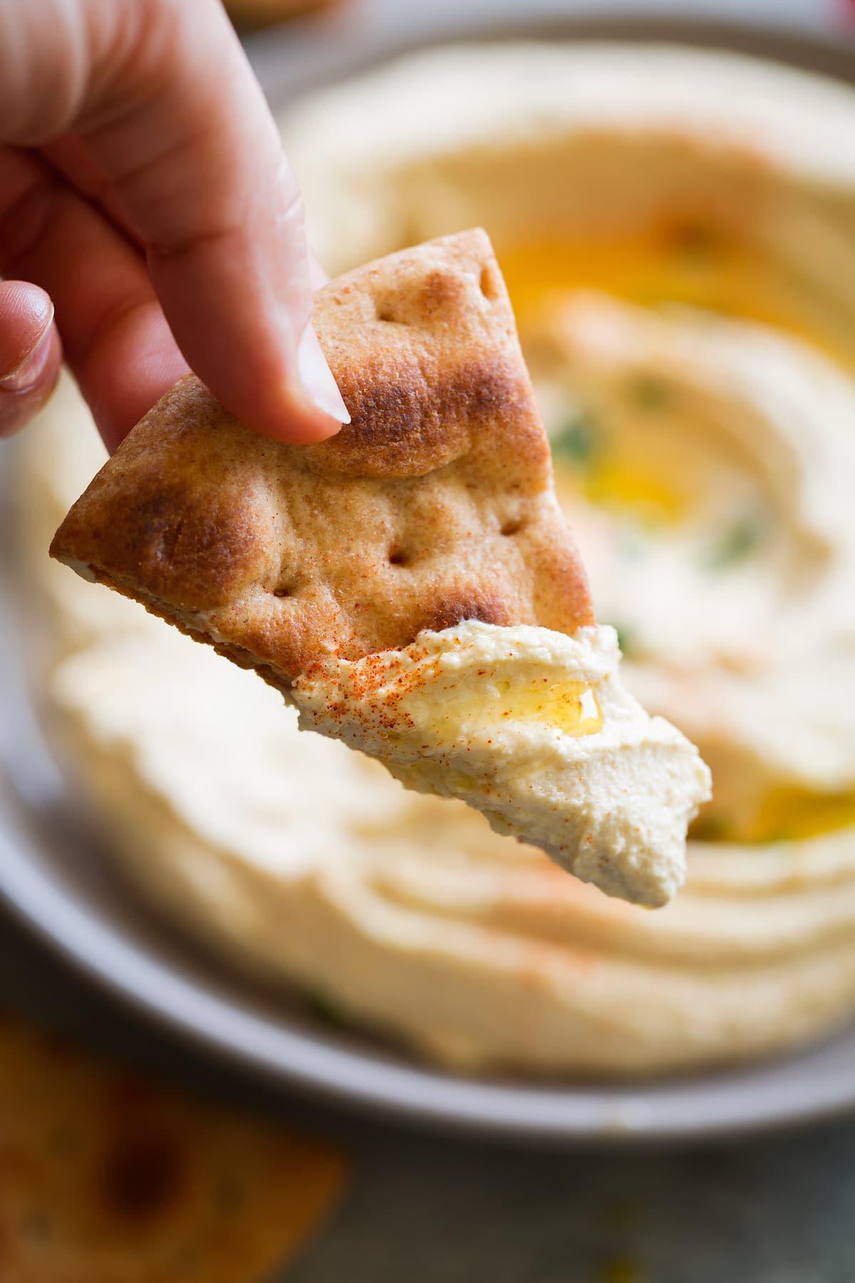 pita chip dunked in homemade hummus