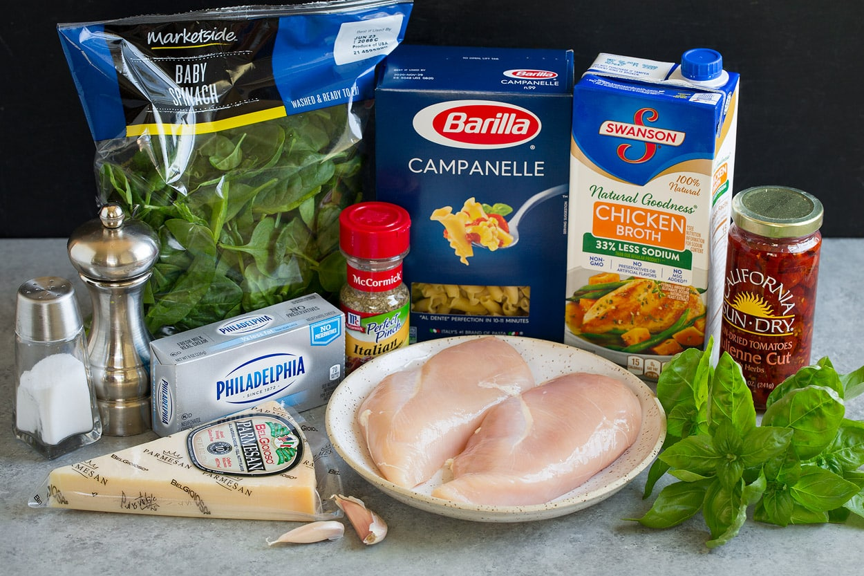 Instant Pot Tuscan Chicken Pasta ingredients parmesan cream cheese spinach italian seasoning pasta chicken chicken broth basil garlic sun dried tomatoes