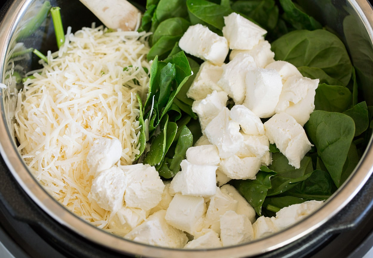 Instant Pot Tuscan Chicken Pasta adding cream cheese parmesan and spinach