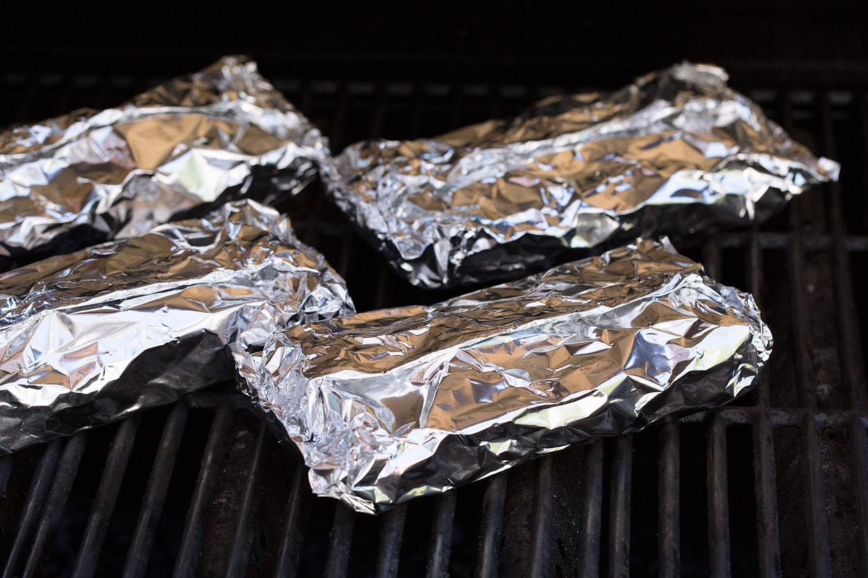 Shrimp and Veggie Foil Packs wrapped on grill