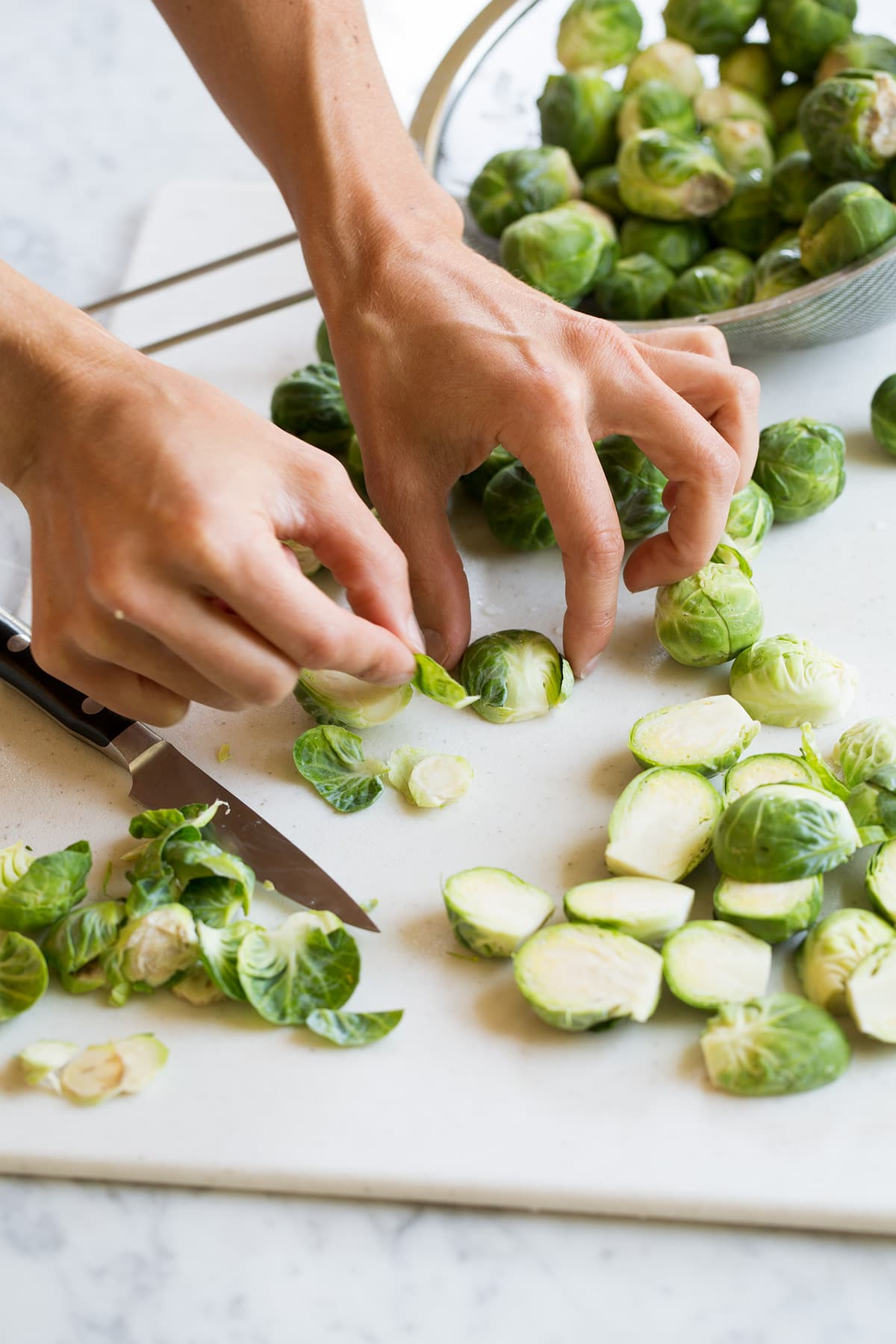 Photo of showing how to prep brussels sprouts before roasting