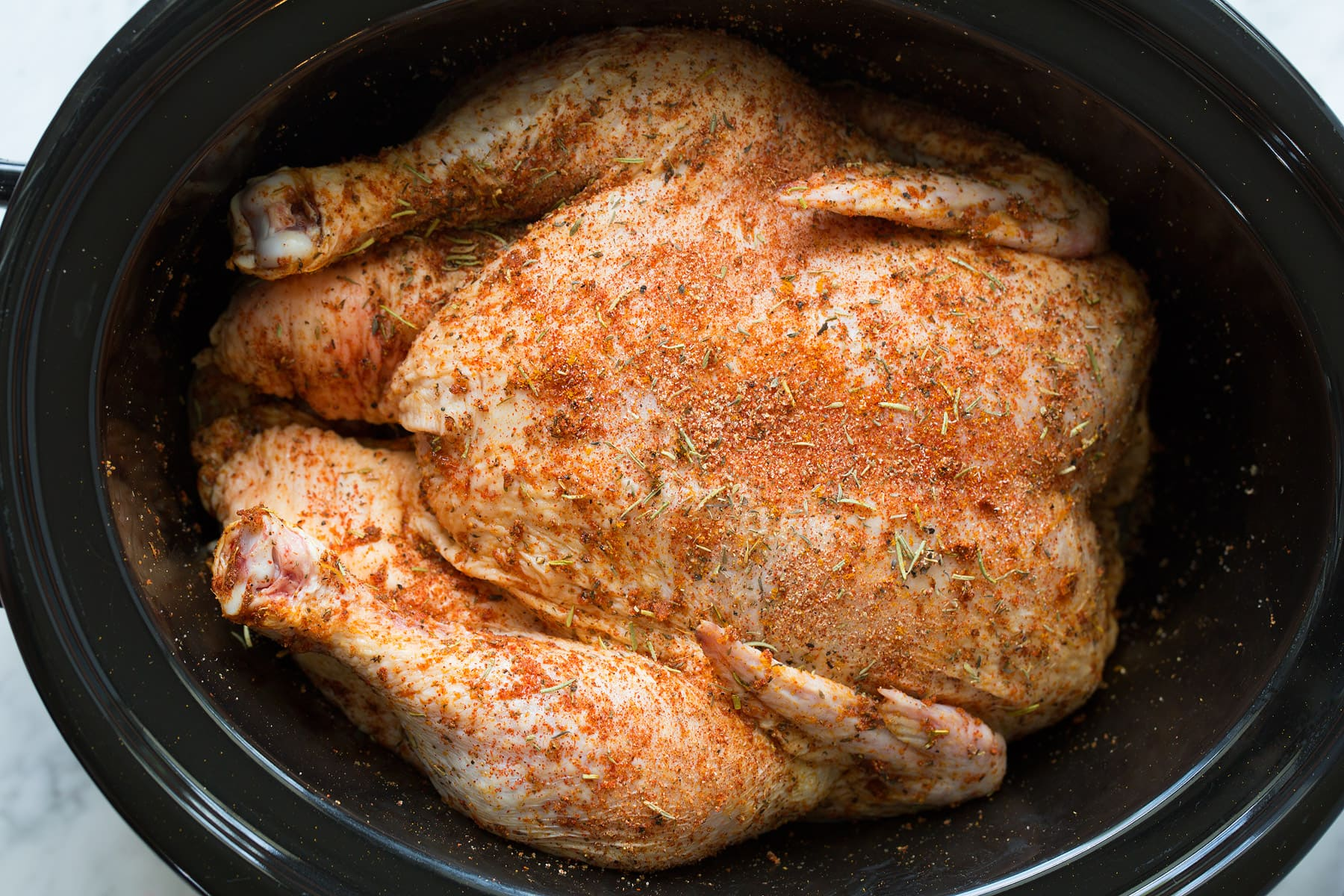 Slow cooker chicken before cooking in slow cooker
