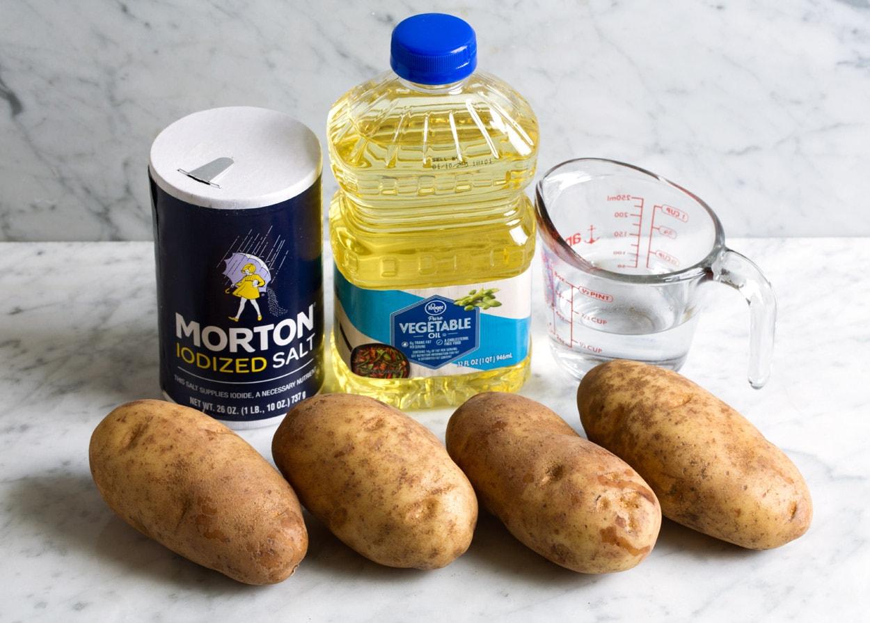 Baked Potatoes ingredients shown here potatoes water salt vegetable oil
