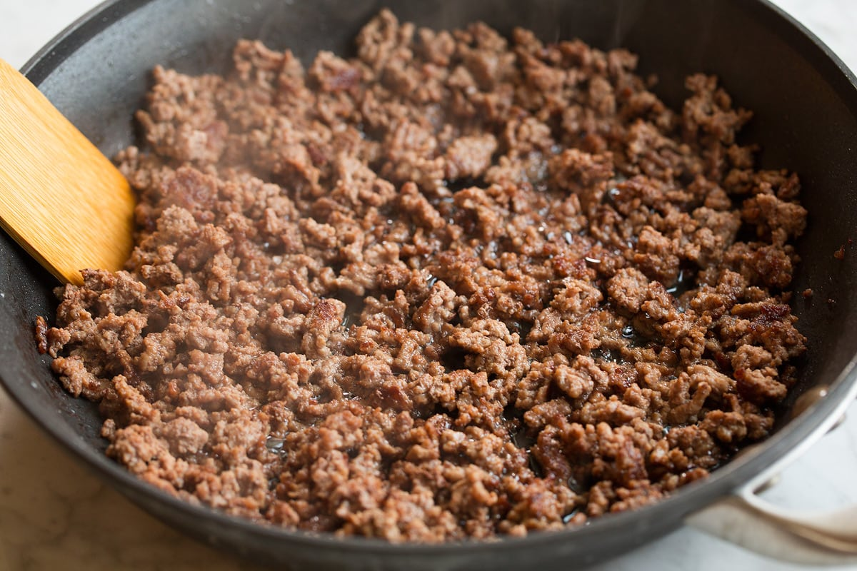 Ground beef in skillet after crumbled and cooked.