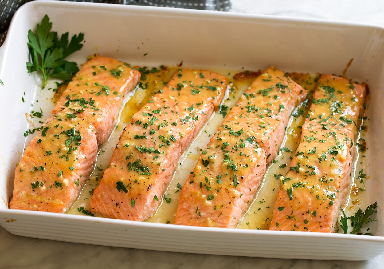 Showing what salmon should look like after baking for doneness.