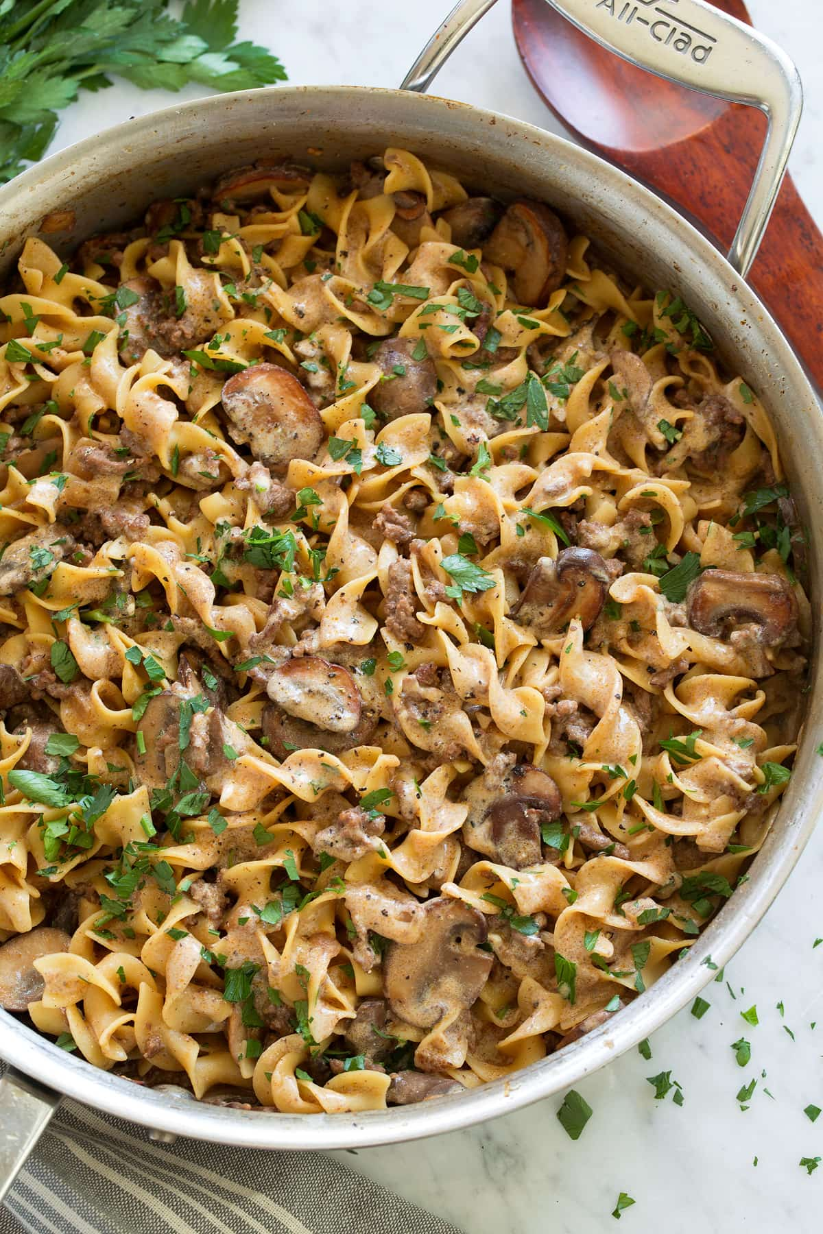 Close up overhead image of beef stroganoff in a saute pan.