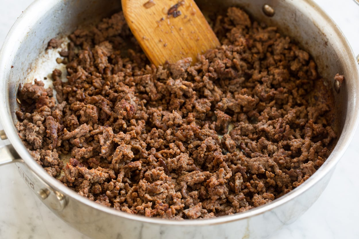 Cooked ground beef pictured here in saute pan.