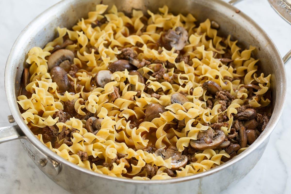 Adding chicken broth to saute pan for beef stroganoff