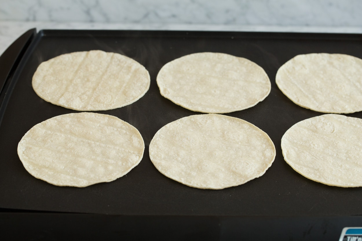 Heating tortillas on griddle to make pliable for enchiladas