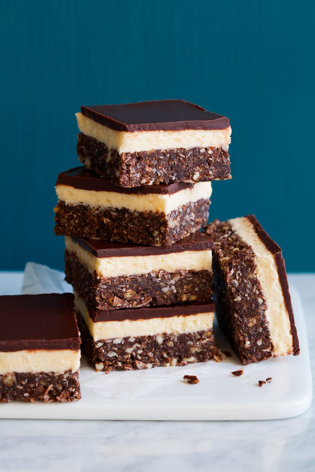 Image of four stacked Nanaimo bars with two resting on the side.