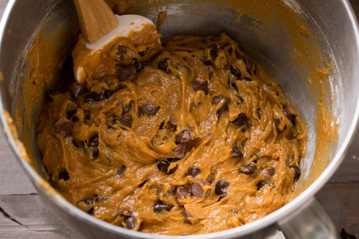 Pumpkin Chocolate Chip Cookie batter in a mixing bowl.