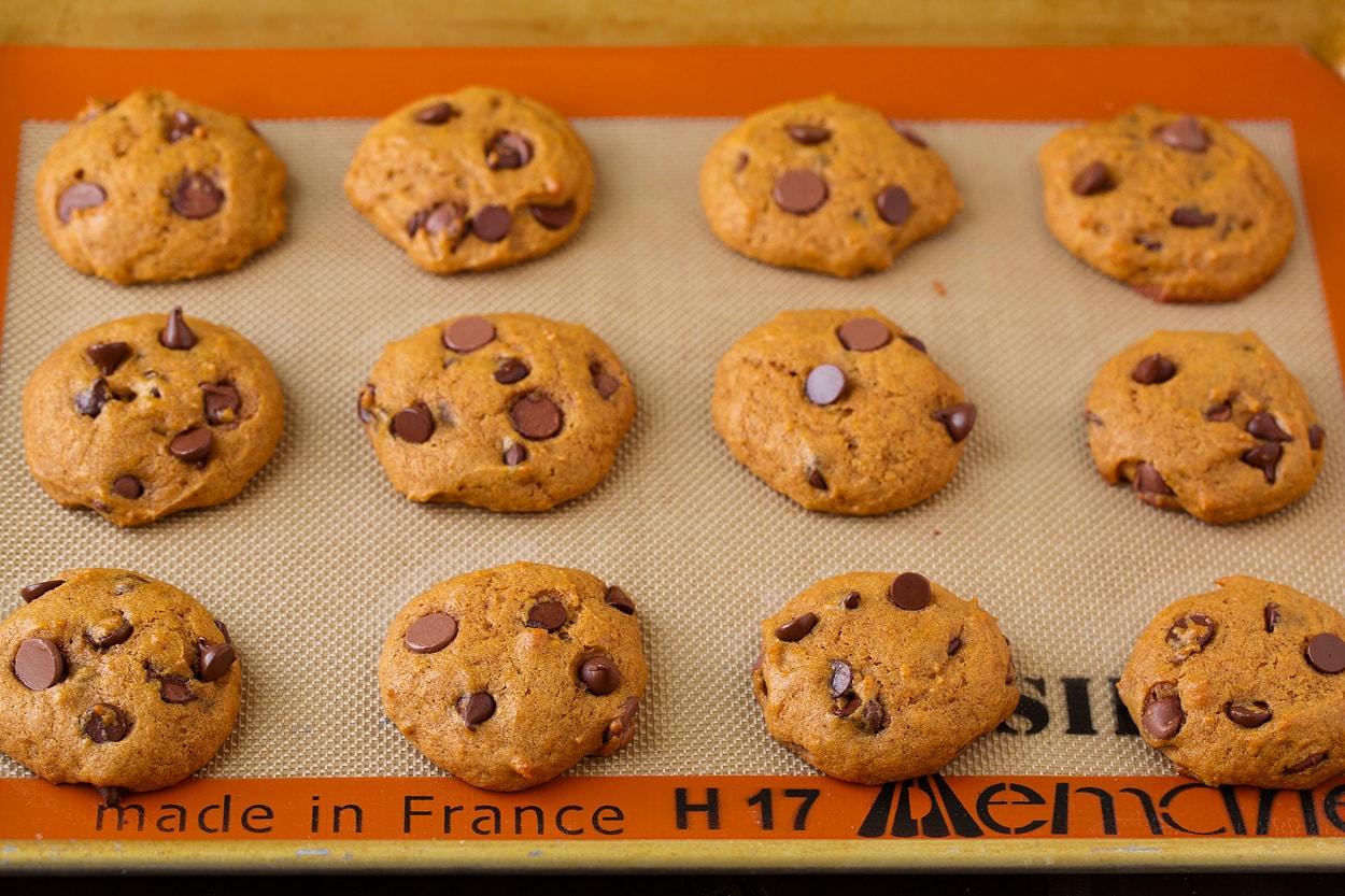 Pumpkin Chocolate Chip Cookies on baking sheet after baking.