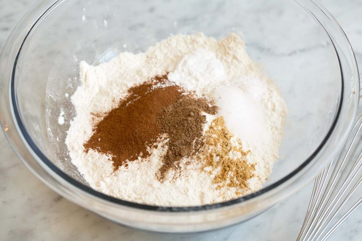 Pumpkin muffins shown here whisking dry ingredients together in mixing bowl