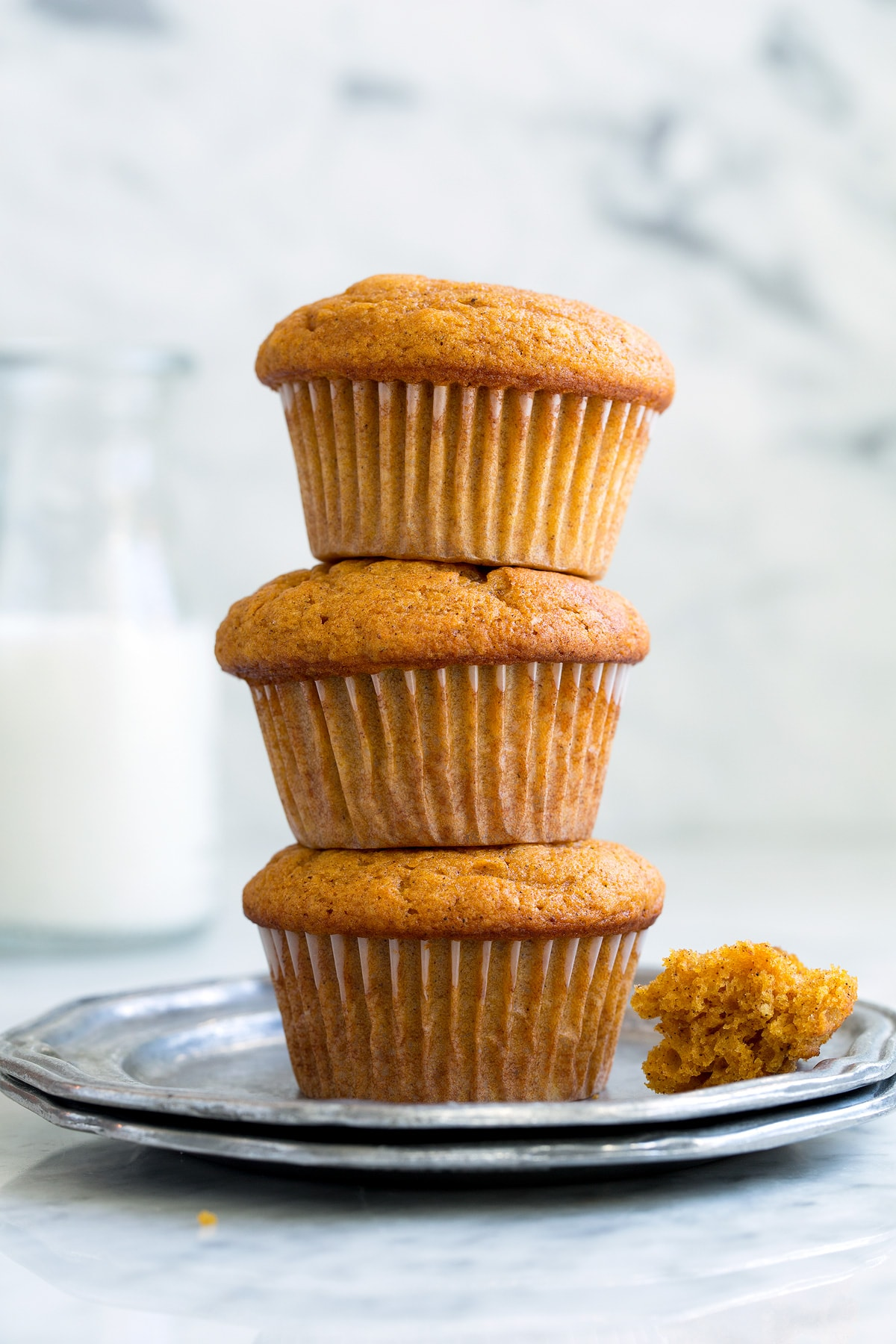 Stack of Pumpkin Muffins on a small pewter plate