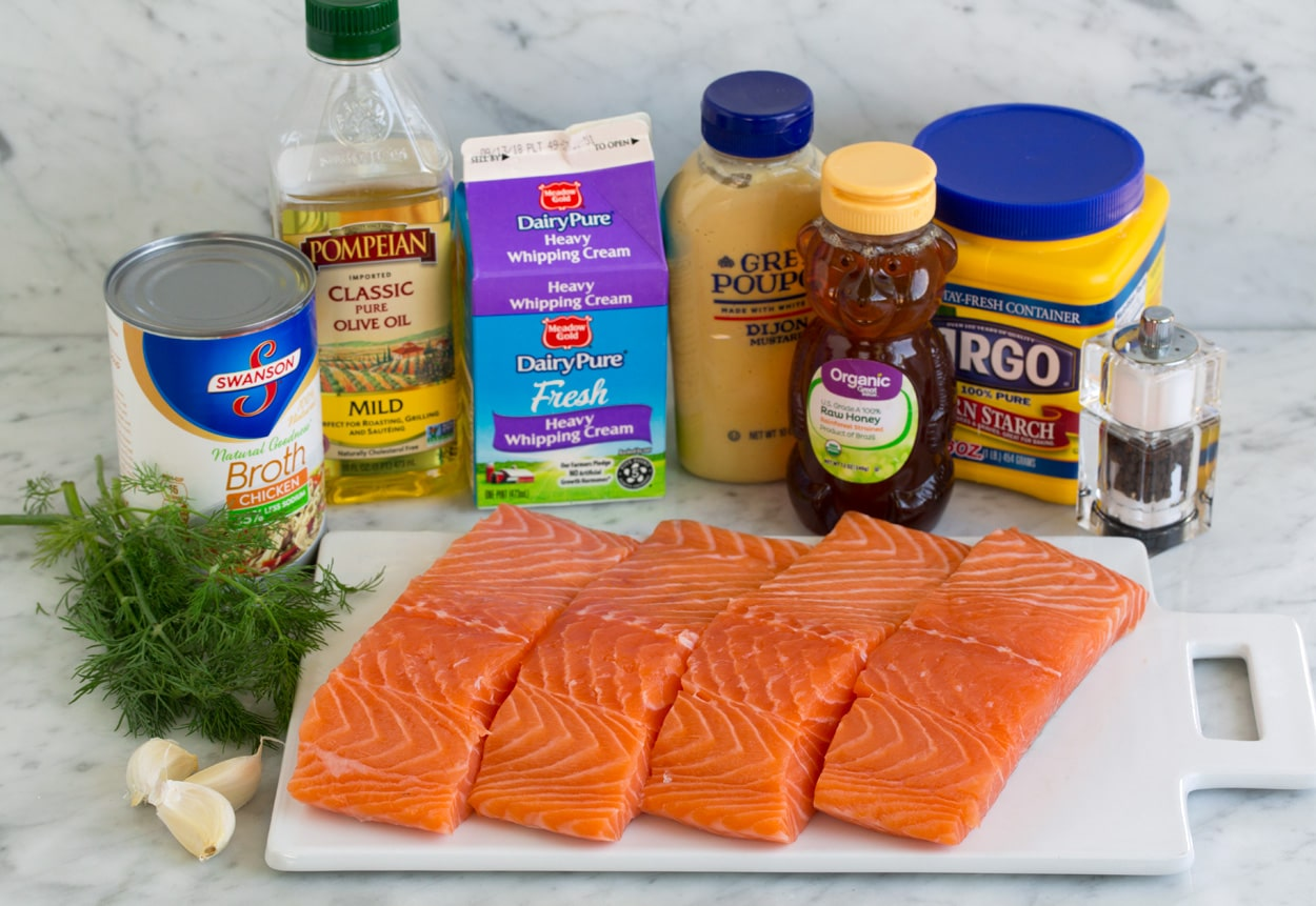 Ingredients for salmon shown here. Salmon fillets, garlic, dill, chicken broth, olive oil, cream, dijon, honey and cornstarch.