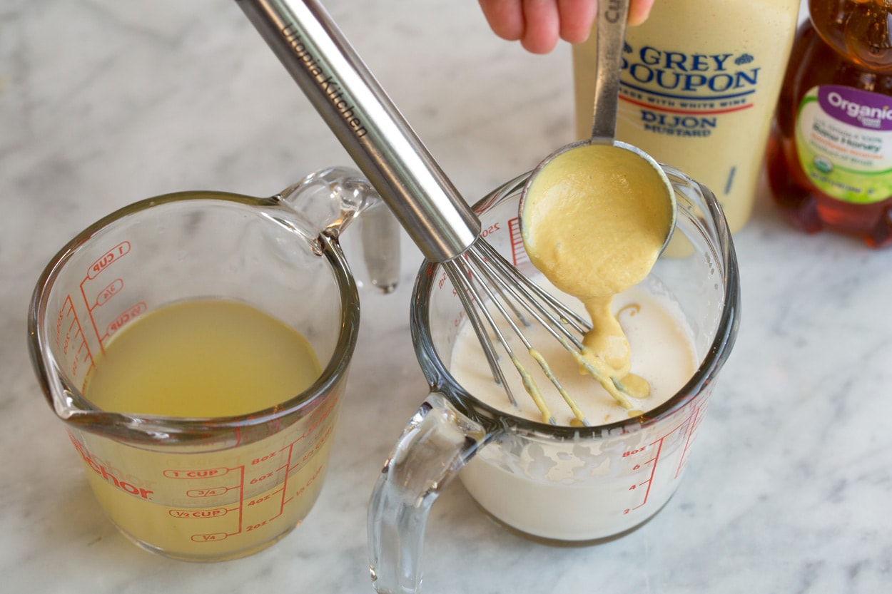 Mixing dijon into cream in measuring cup to make sauce for Salmon.