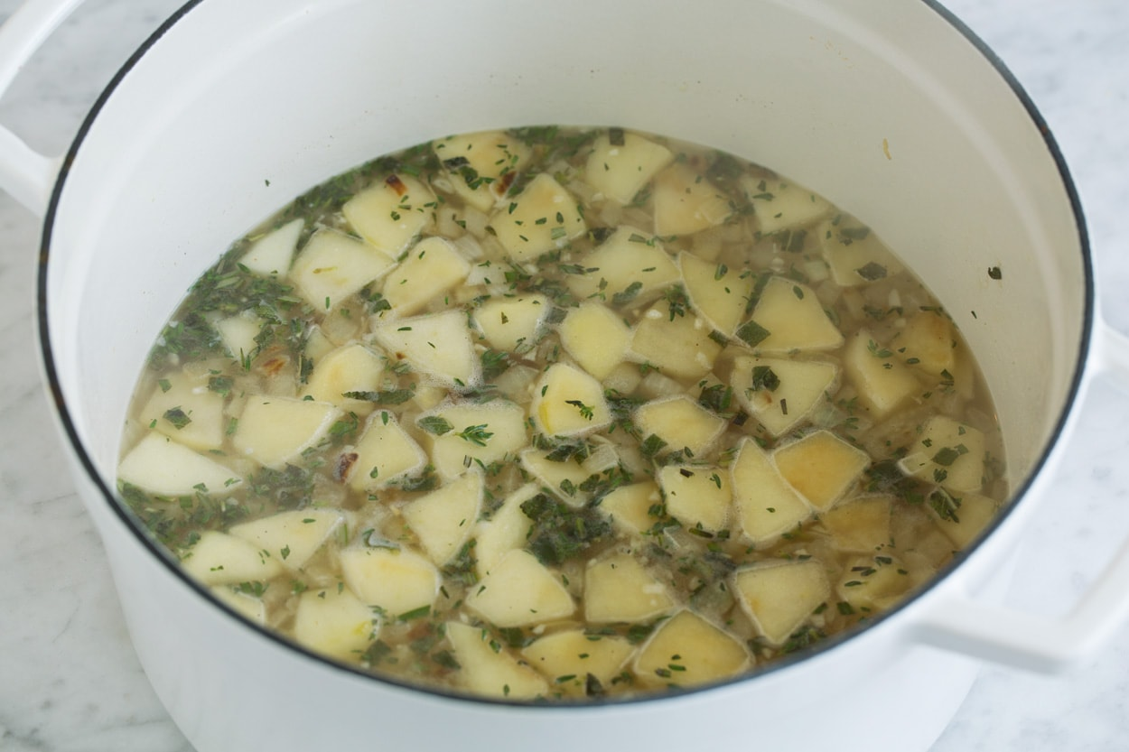 Shown here adding chicken broth to soup mixture for butternut squash soup