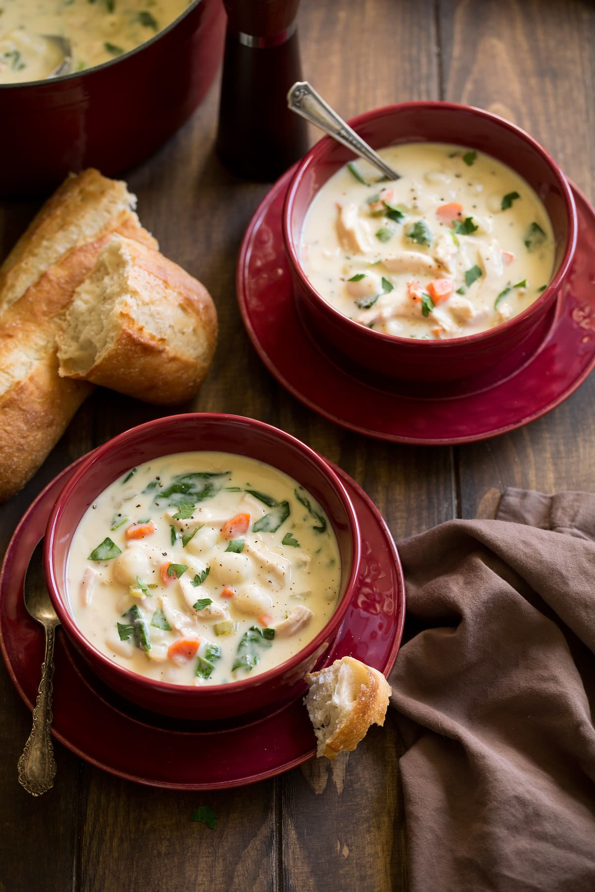 Two servings of creamy chicken gnocchi soup.