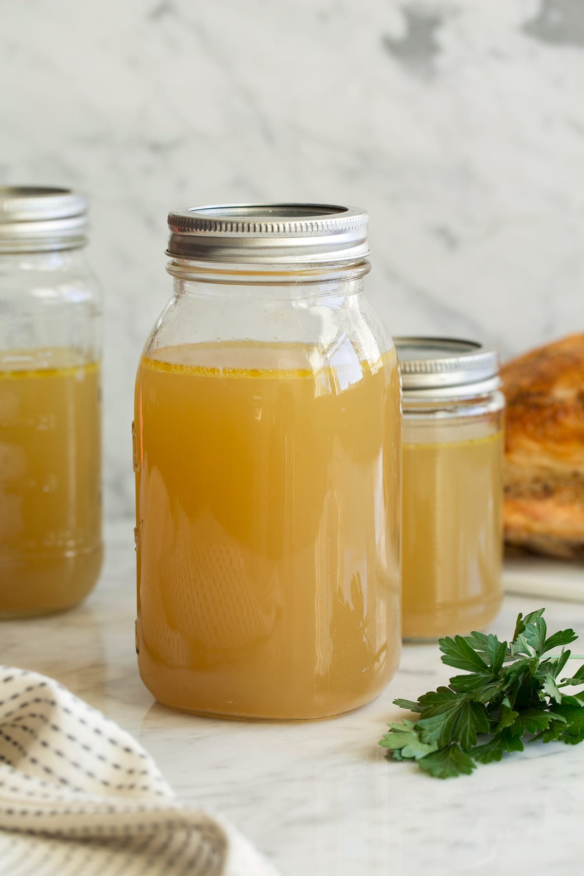 Homemade Chicken Stock in storage jars.