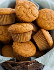 Pumpkin Muffins shown here in a basket lined with light blue burlap fabric