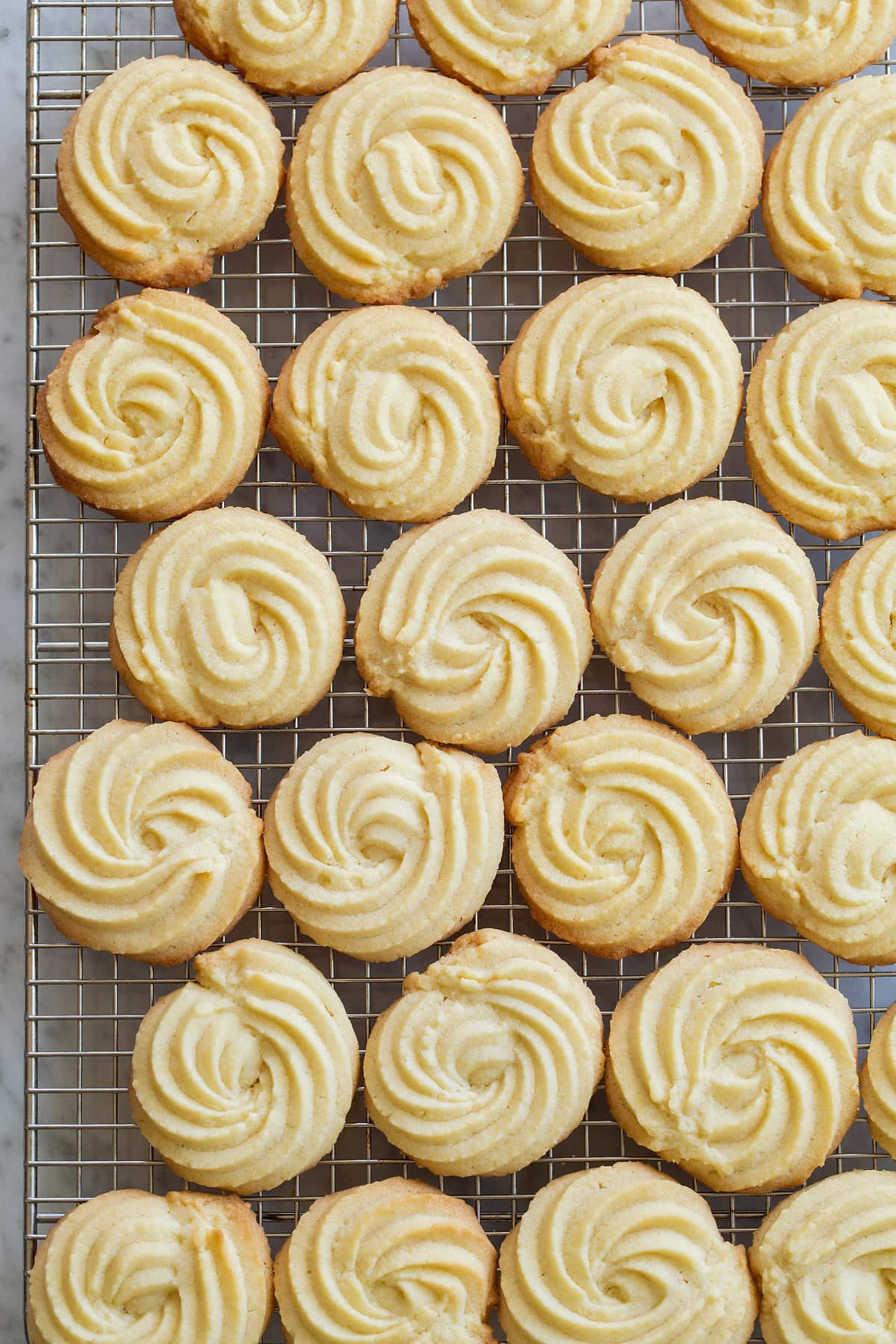 Butter cookies on a cooling rack.