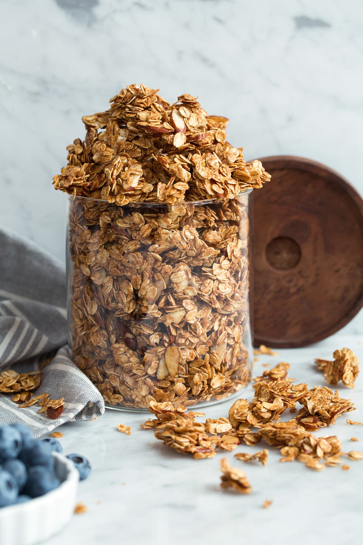 Homemade granola in a glass storage jar.