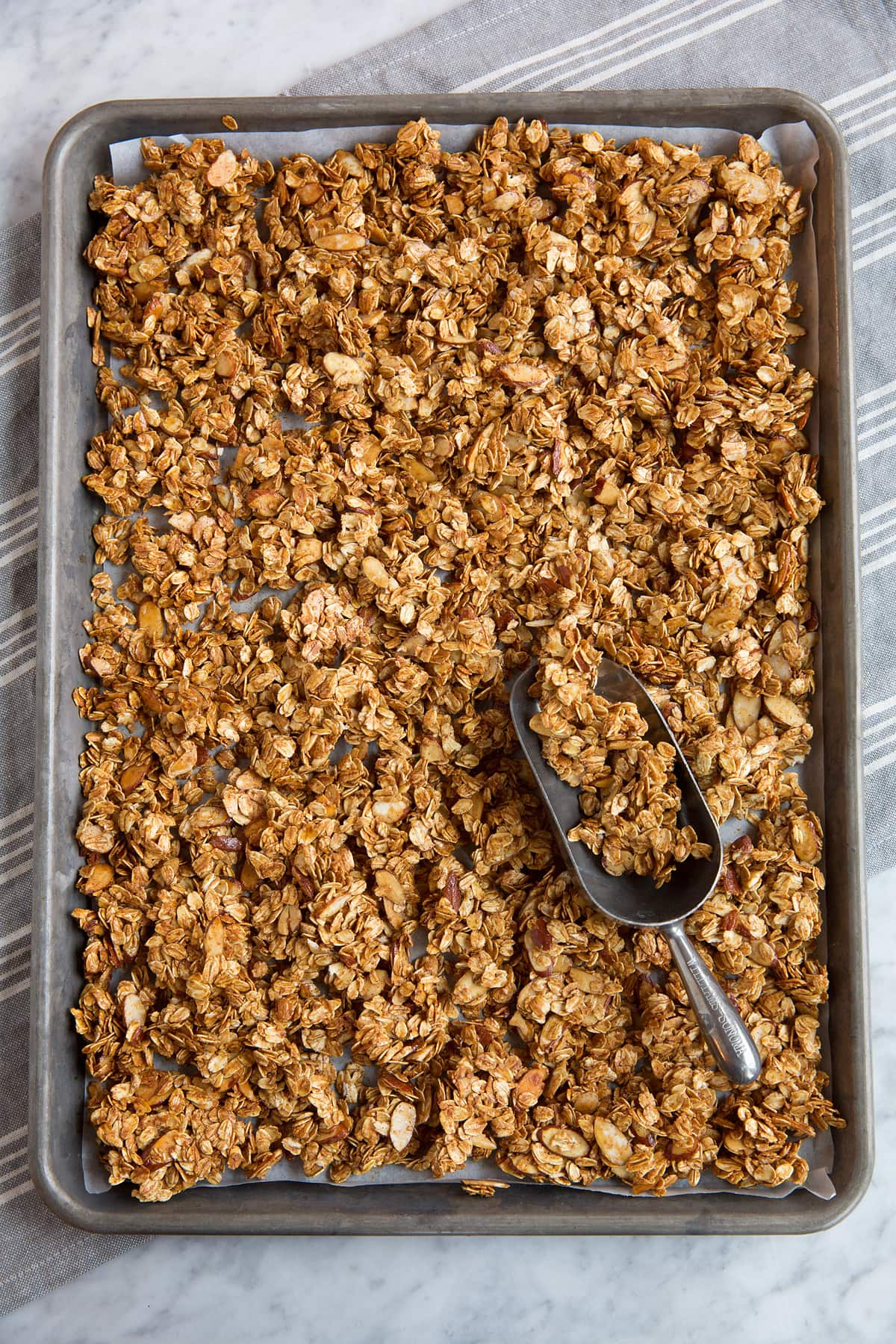 Granola on baking sheet after baking.