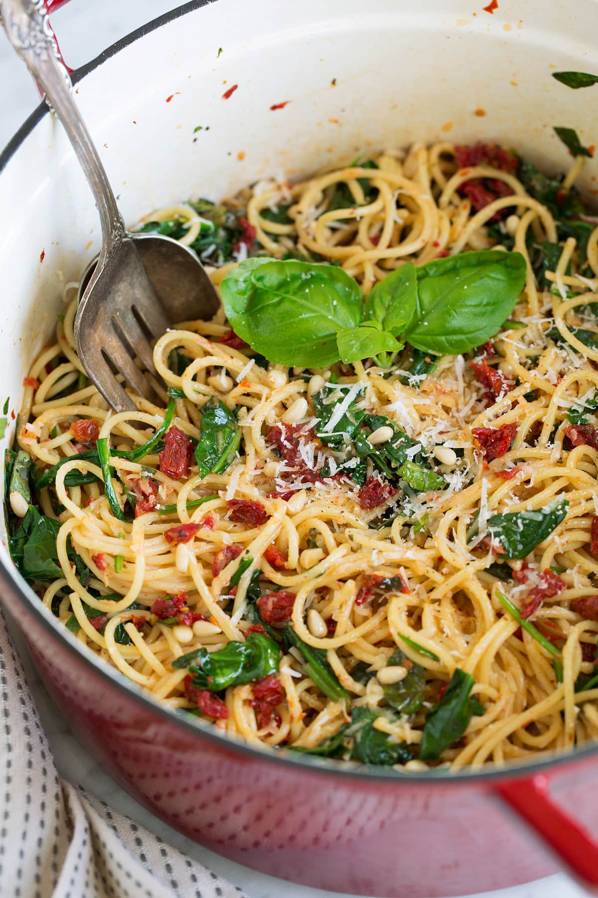 sun dried tomato pasta with spinach in large pot