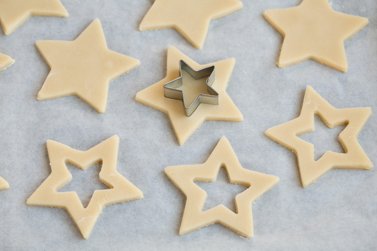 Cutting center portion from cookies with a small star cookie cutter.