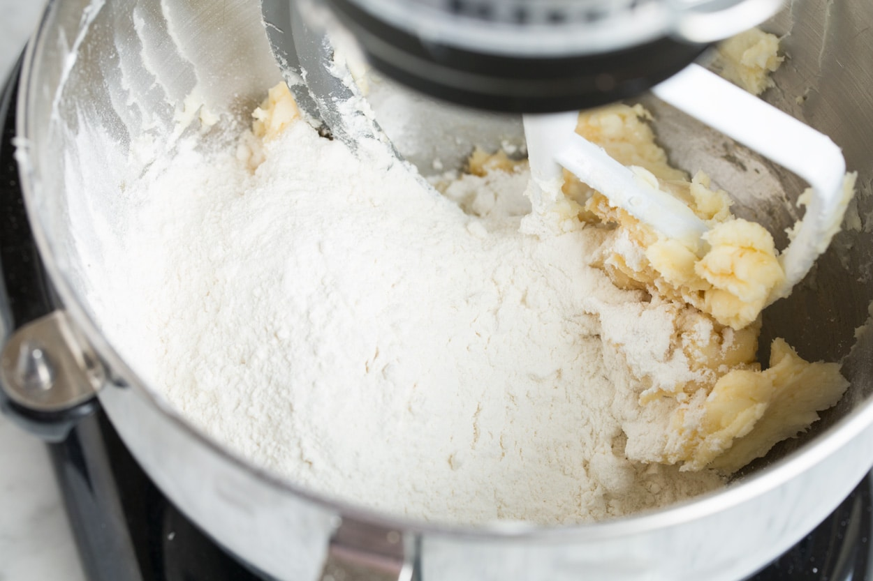 Mixing flour into Mexican Wedding Cookie dough.