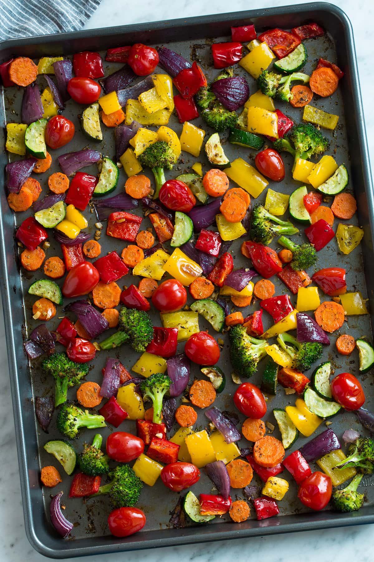 Overheat image of Roasted Vegetables on a dark baking sheet.