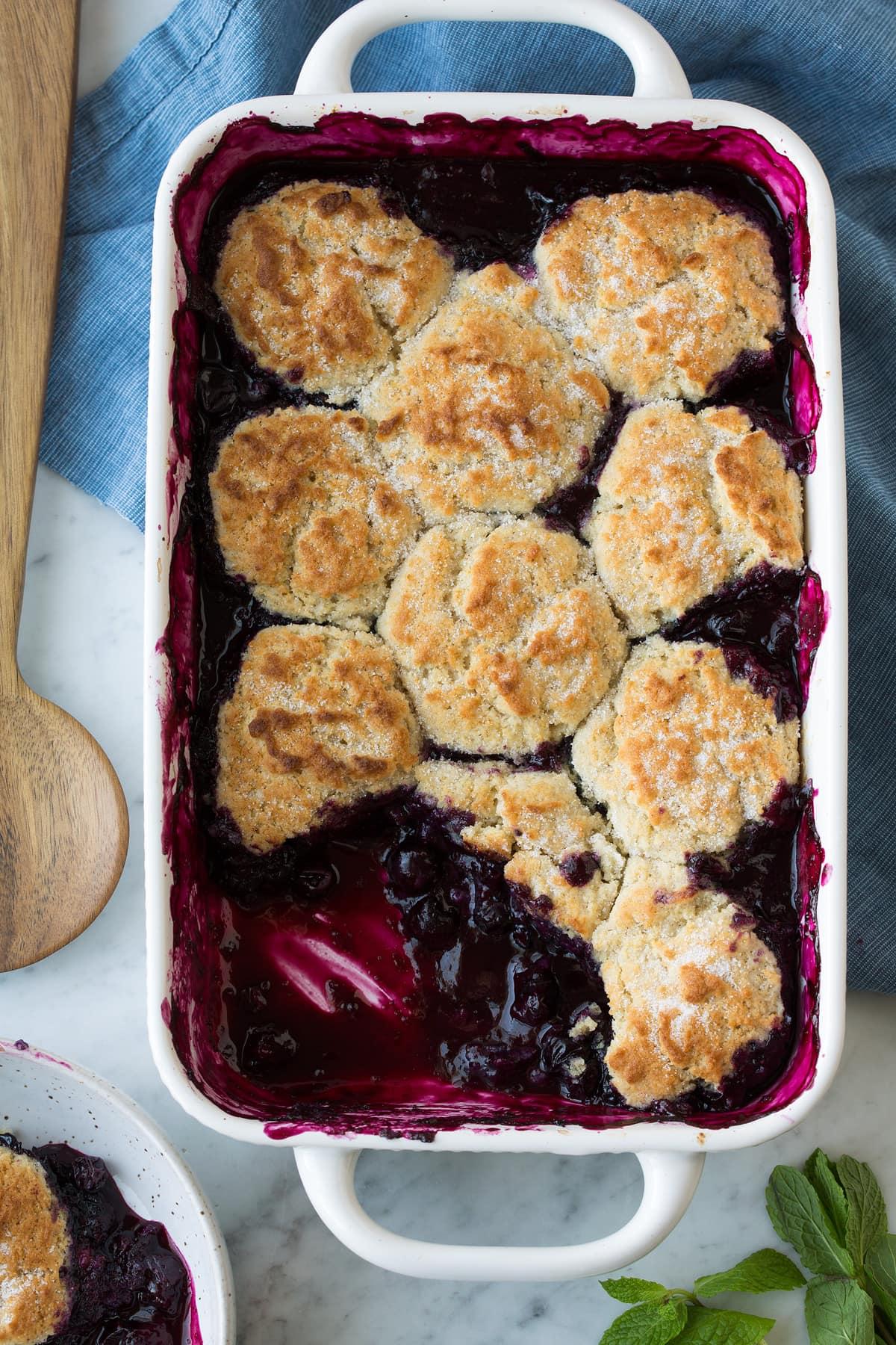 Blueberry Cobbler in white baking dish
